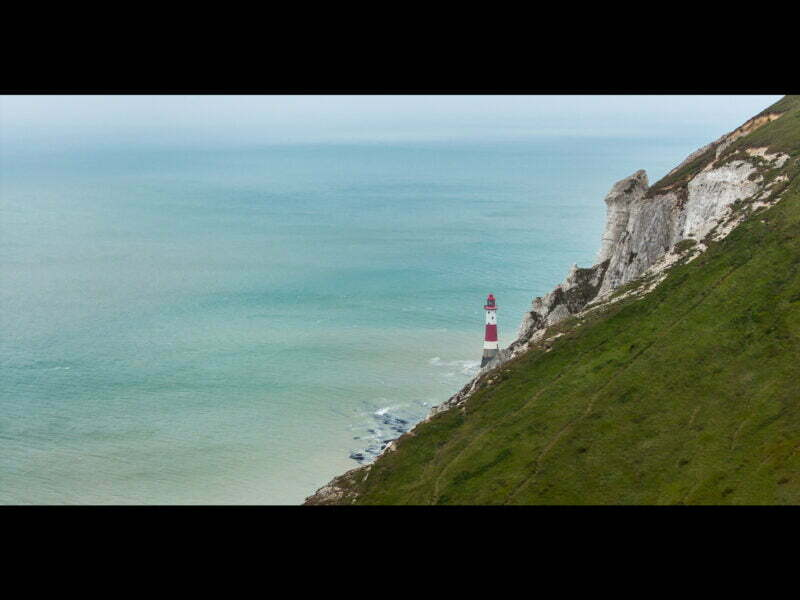 A view of Beachy Head lighthouse from the cliff above