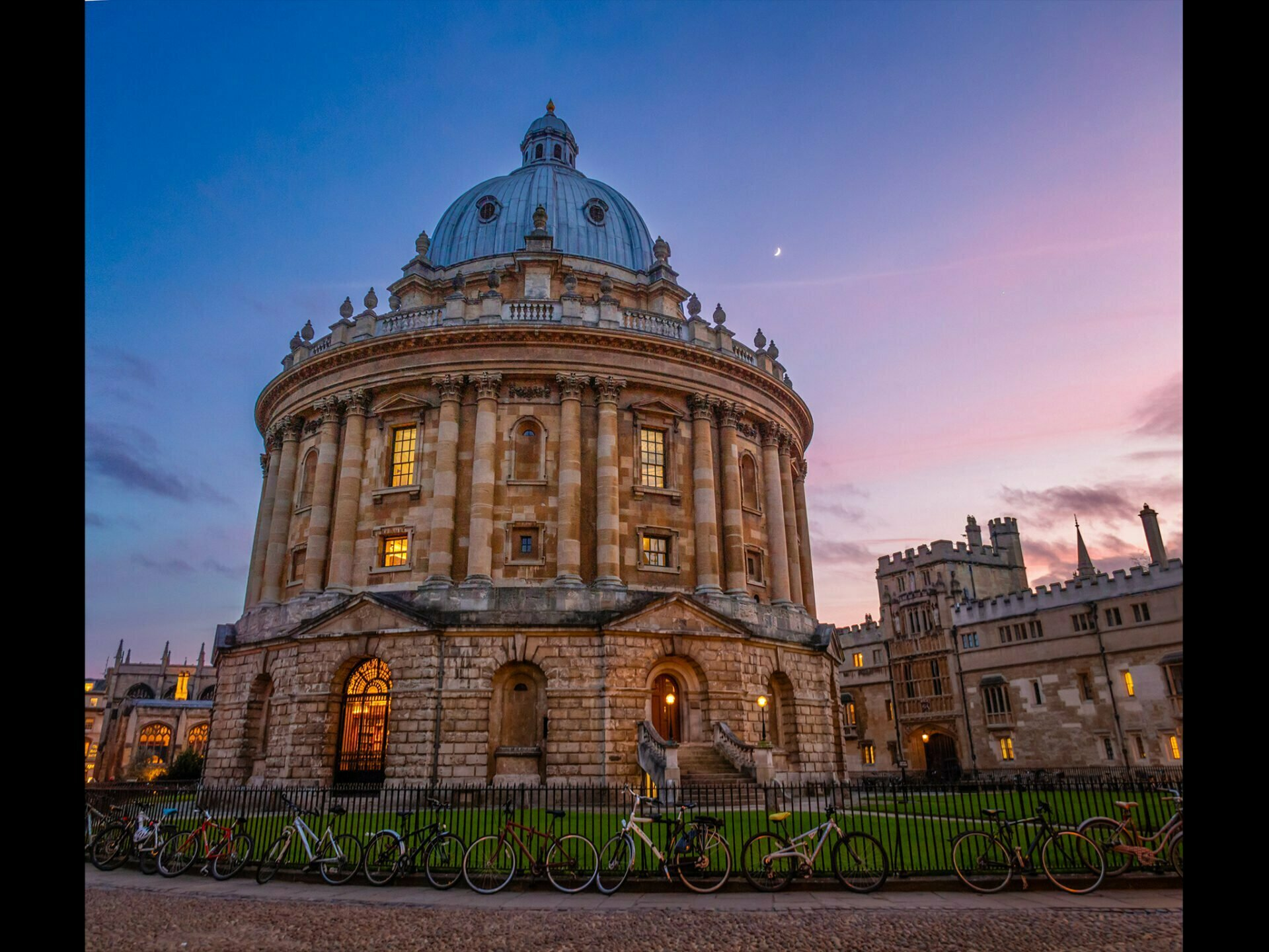 The Radcliffe Camera with a beautiful pink and blue sky behind with the moon barely visible
