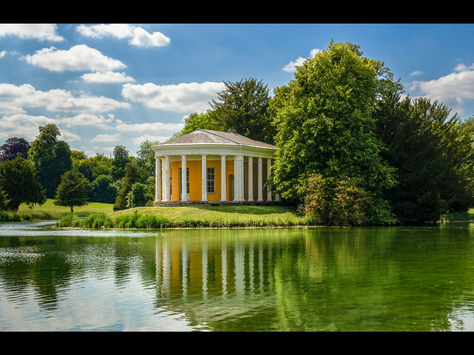 A classical building in the middle of a lake at West Wycombe