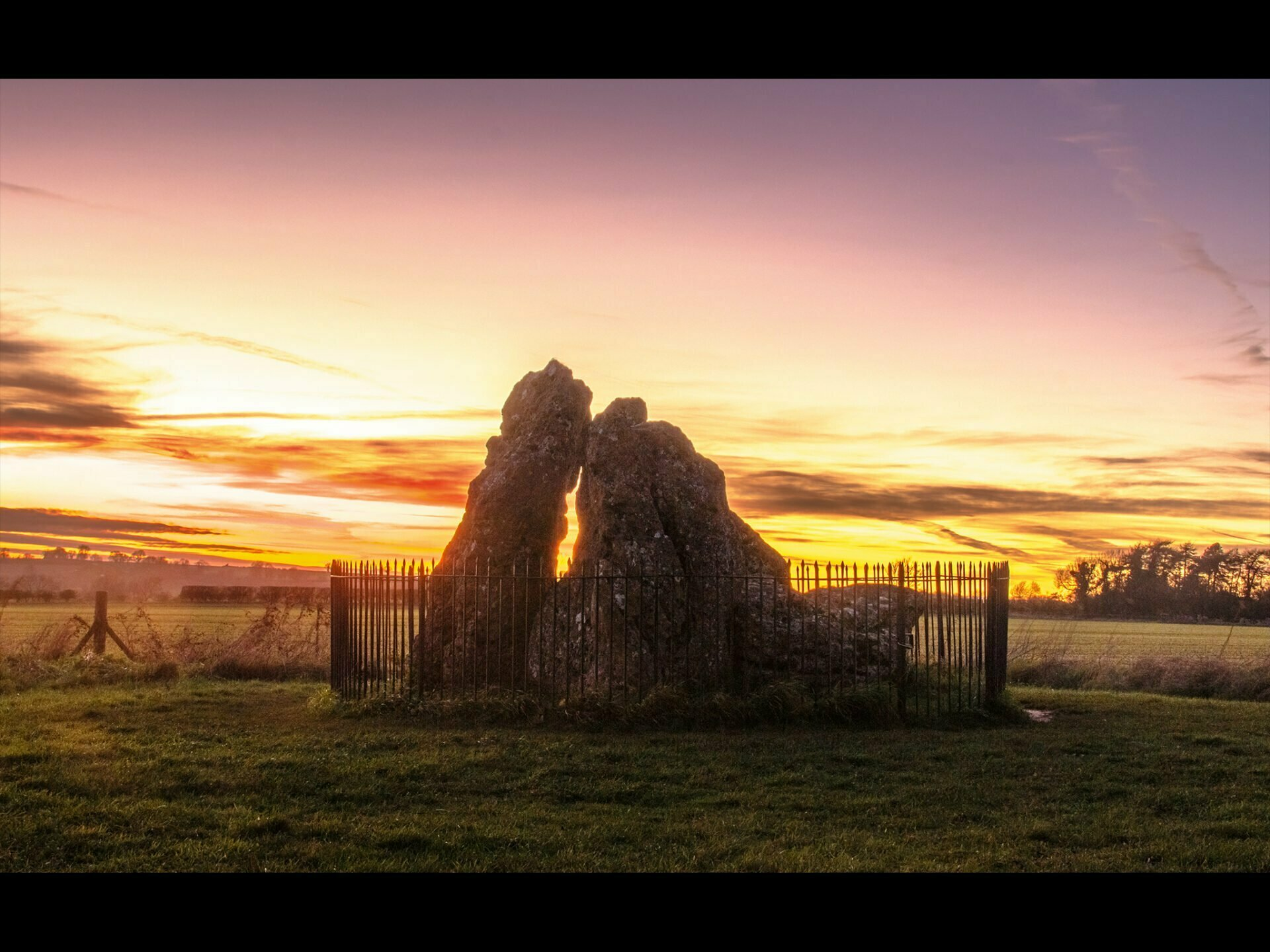 whispering knights neolithic stones at sunset