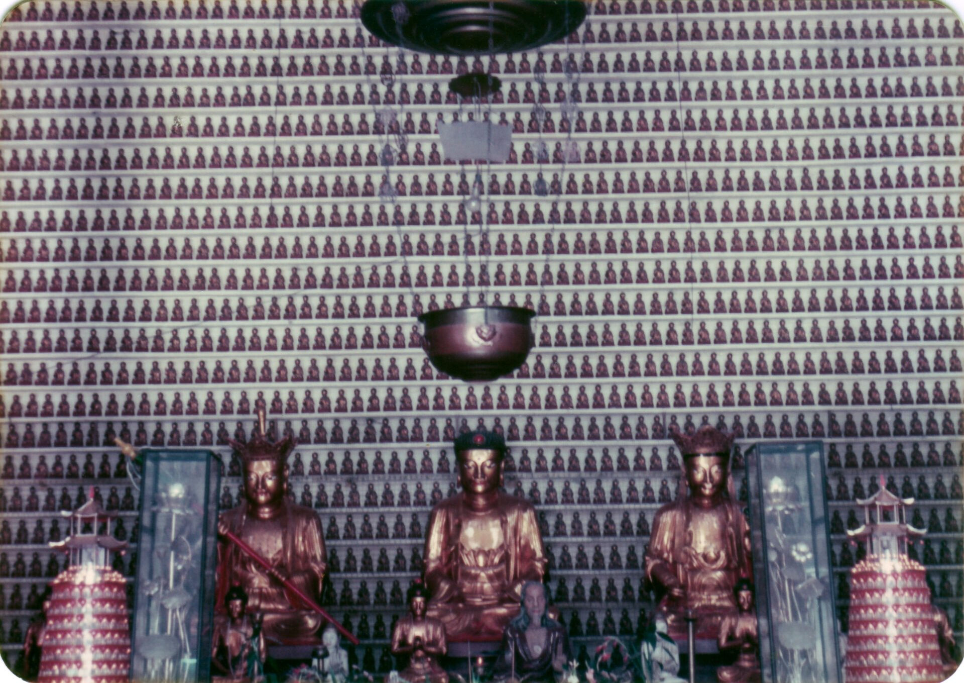 Temple of ten thousand Buddhas they reach ceiling on 3 walls